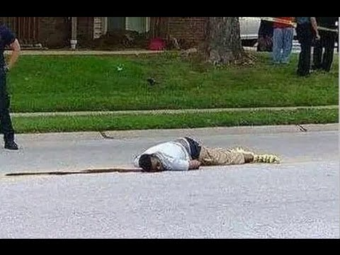 August 9, 2014 Mike Brown lays dead in the street in Ferguson, Missouri after being shot by a police officer.