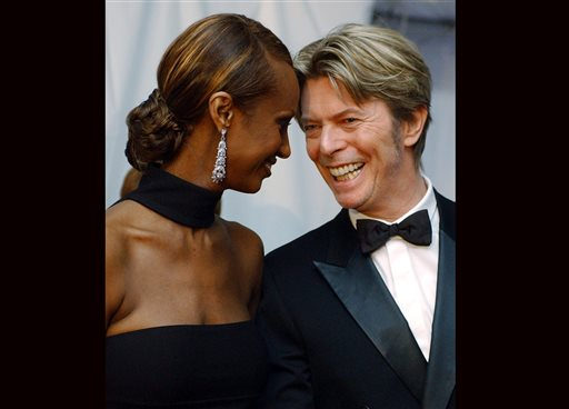 FILE - In this June 3, 2002, file photo, Iman, left, and her husband, singer David Bowie arrive at the Council of Fashion Designers of America Fashion Awards in New York. Bowie, the innovative and iconic singer whose illustrious career lasted five decades, died Monday, Jan. 11, 2016, after battling cancer for 18 months. He was 69. (AP Photo/Suzanne Plunkett, File)