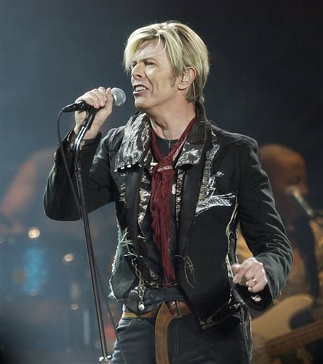 """FILE - In this Dec. 15, 2003 file photo, singer/songwriter David Bowie launches his United States leg of his worldwide tour called """"A Reality Tour,"""" at Madison Square Garden in New York. Bowie, the innovative and iconic singer whose illustrious career lasted five decades, died Monday, Jan. 11, 2016, after battling cancer for 18 months. He was 69 (AP Photo/Kathy Willens, File)"""