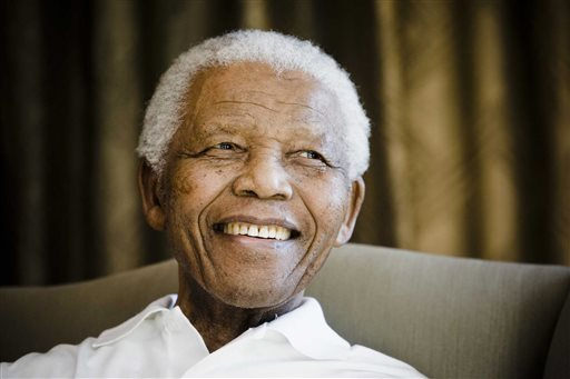 FILE - In this Tuesday, June 2, 2009 file photo, former South African President Nelson Mandela smiles during a meeting with a group of American and South African students in Johannesburg, South Africa. BET says it will air a miniseries about Nelson Mandela next year, with actor Laurence Fishburne portraying the late South African leader. (AP Photo/Theana Calitz-Bilt, Pool, File)