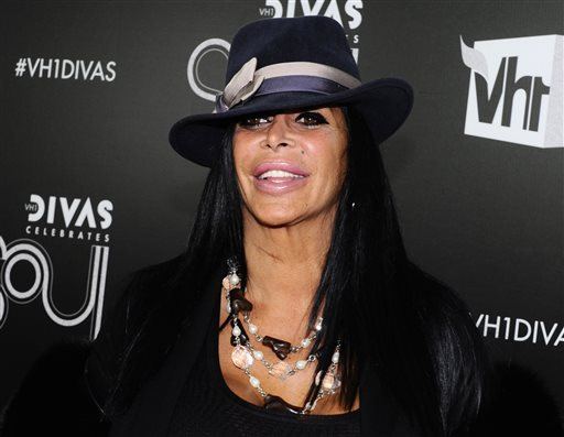 """FILE - In this Dec. 18, 2011, file photo, Angela Raiola, better known as Big Ang, arrives at """"Vh1 Divas Celebrates Soul"""" in New York. Raiola from the reality TV series """"Mob Wives"""" has died following a nearly yearlong battle with cancer, series producer Jennifer Graziano said Thursday, Feb. 18, 2016. (AP Photo/Charles Sykes, File)"""