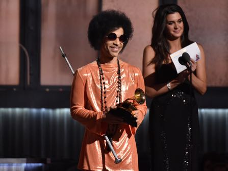 FILE - In this Feb. 8, 2015, file photo, Prince presents the award for album of the year at the 57th annual Grammy Awards in Los Angeles. Beyond dance parties and hit songs, Prince's legacy included black activism. He said black lives matter before presenting a 2015 Grammy. (Photo by John Shearer/Invision/AP, File)