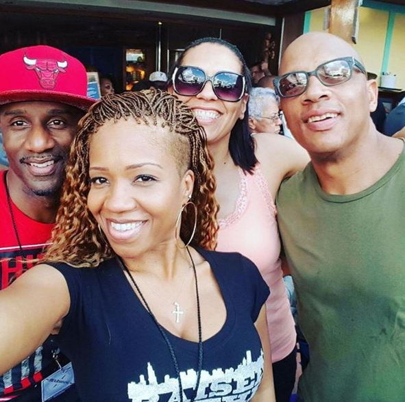 Damon Williams snaps a flick with his wife and friends.