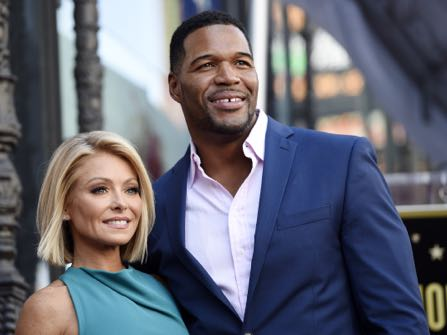 """FILE - In this Oct. 12, 2015 file photo, Kelly Ripa, left, poses with Michael Strahan, her co-host on the daily television talk show """"LIVE! with Kelly and Michael,"""" during a ceremony honoring Ripa with a star on the Hollywood Walk of Fame in Los Angeles. Ripa returns as co-host of the morning show after a four-day absence after ABC announced Tuesday that co-host Strahan will leave the show to join """"Good Morning America"""" full-time.   (Photo by Chris Pizzello/Invision/AP, File)"""