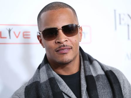 """FILE- In this Jan. 20, 2016, file photo, T.I. arrives at the grand opening of """"Jennifer Lopez: All I Have"""" show at Planet Hollywood Resort & Casino in Las Vegas. According to authorities several people were shot at a T.I concert in New York, Wednesday, May 25, 2016. (Photo by Omar Vega/Invision/AP, File)"""
