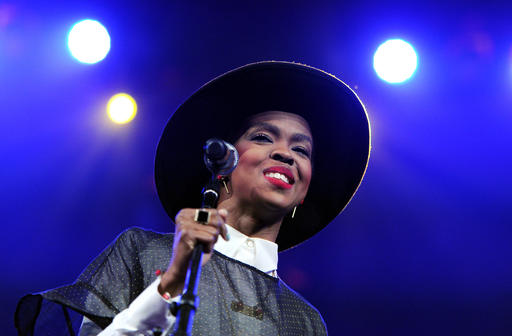 """FILE - In this Feb. 5, 2014 file photo, singer Lauryn Hill performs at Amnesty International's """"Bringing Human Rights Home"""" Concert at the Barclays Center in New York. Hill says that she will """"make it up"""" to her fans after she enraged those in attendance at an Atlanta concert Friday, May 6, 2016, by arriving two hours late and performing for fewer than 40 minutes. (Photo by Evan Agostini/Invision/AP, File)"""