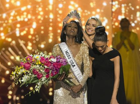 Miss District of Columbia Deshauna Barber is crowned Miss USA by Miss USA 2015 Olivia Jordan during the 2016 Miss USA pageant in Las Vegas, Sunday, June 5, 2016. (Jason Ogulnik/Las Vegas Review-Journal via AP) LOCAL TELEVISION OUT; LOCAL INTERNET OUT; LAS VEGAS SUN OUT