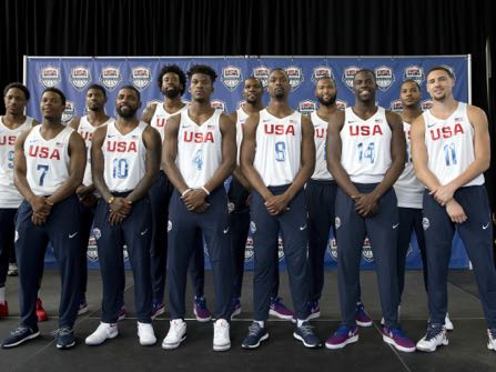 The U.S. men's Olympic basketball team poses for a photo with head coach during a news conference, Monday, June 27, 2016, in New York. (AP Photo/Mary Altaffer)