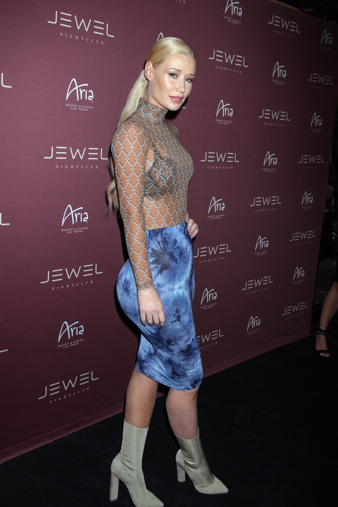 07/23/2016 - Iggy Azalea - Iggy Azalea Arrives for a Special Performance at Jewel Nightclub in Las Vegas on July 23, 2016 - Jewel Nightclub at Aria Resort & Casino - Las Vegas, NV, USA - Keywords: Grey Boots, Full Length Shot, Blue Skirt, Bracelet, Jewelry, See Through Long Sleeve Blouse, Black Bra, Pulled Back Long Wavy Blond Hair, Updo, Ponytail, Vertical, Musician, Performer, Music, Arrival, Portrait, Photography, Arts Culture and Entertainment, Rapper, Woman, Person, People, Celebrity, Celebrities, Nevada, Aria Resort and Casino Orientation: Portrait Face Count: 1 - False - Photo Credit: PRN / PRPhotos.com - Contact (1-866-551-7827) - Portrait Face Count: 1