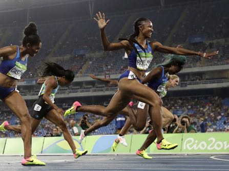 Brianna Rollins from the United States celebrates after winning the gold medal in the women's 100-meter hurdles final during the athletics competitions of the 2016 Summer Olympics at the Olympic stadium in Rio de Janeiro, Brazil, Wednesday, Aug. 17, 2016. (AP Photo/Matt Dunham)