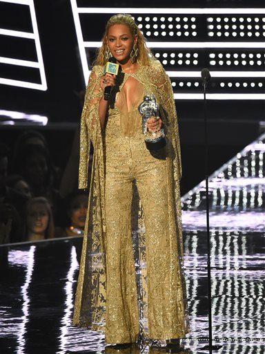"Beyonce accepts the award for best female video for ""Hold Up"" at the MTV Video Music Awards at Madison Square Garden on Sunday, Aug. 28, 2016, in New York. (Photo by Charles Sykes/Invision/AP)"
