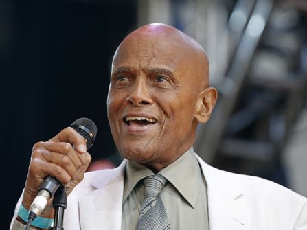 FILE - In this July 20, 2014 file photo, singer and activist Harry Belafonte speaks during a memorial tribute concert for folk icon and civil rights activist Pete Seeger at Lincoln Center's Damrosch Park in New York. The Academy of Motion Picture Arts and Sciences will present Honorary Awards to Jean-Claude Carrière, Hayao Miyazaki and Maureen O'Hara, and the Jean Hersholt Humanitarian Award to Belafonte. All four awards will be presented at the Academy's 6th Annual Governors Awards on Saturday, November 8, 2014, at the Ray Dolby Ballroom at Hollywood & Highland Center in Los Angeles. (AP Photo/Kathy Willens, File)