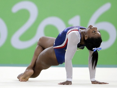United States' Simone Biles performs on the floor during the artistic gymnastics women's individual all-around final at the 2016 Summer Olympics in Rio de Janeiro, Brazil, Thursday, Aug. 11, 2016. (AP Photo/David Goldman)