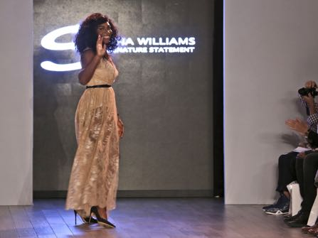 Serena Williams greets the crowd after showing her Serena Williams Signature Statement Spring 2017 collection during Fashion Week in New York, Monday, Sept. 12, 2016. (AP Photo/Seth Wenig)