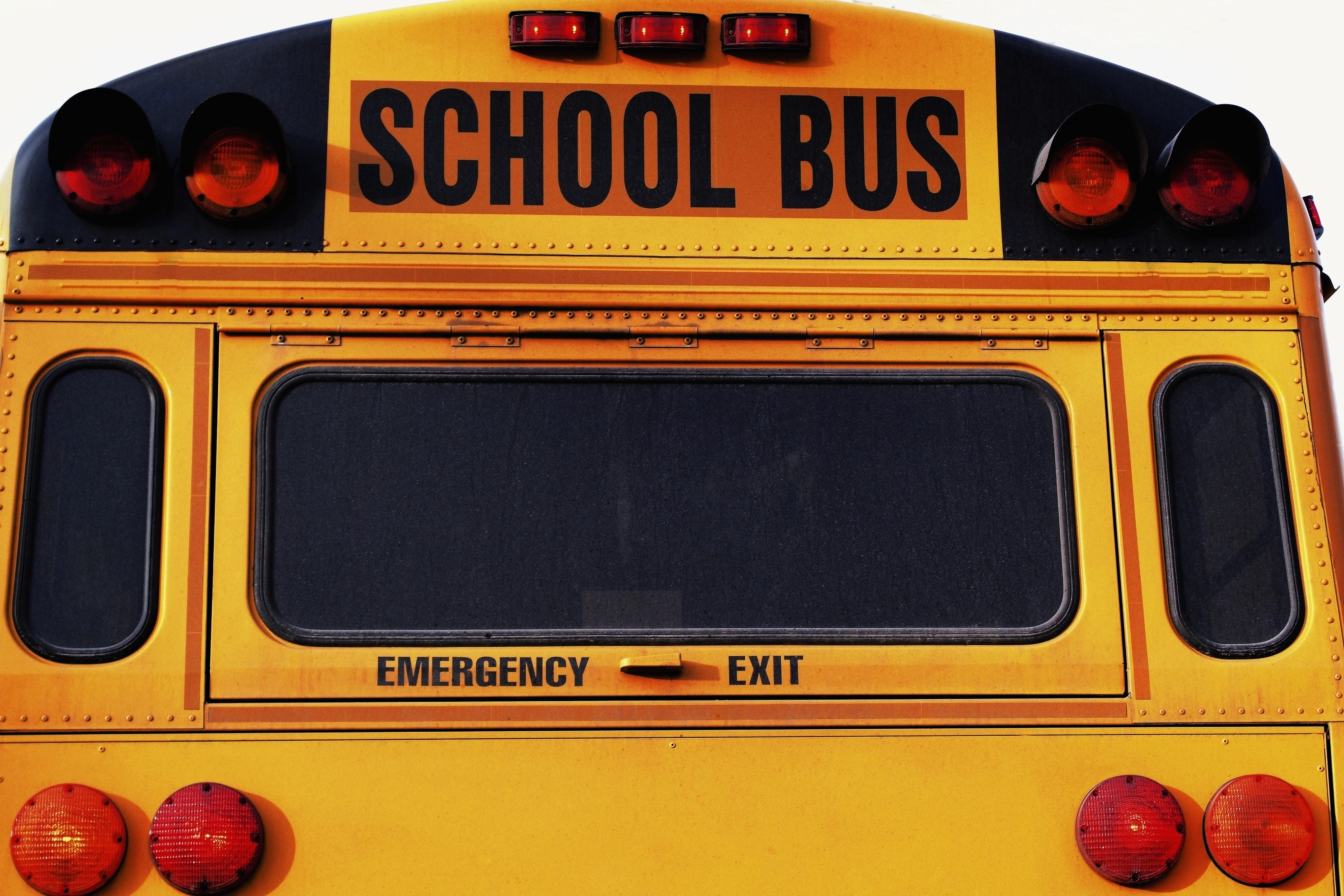 Front of yellow school bus, close-up, part of