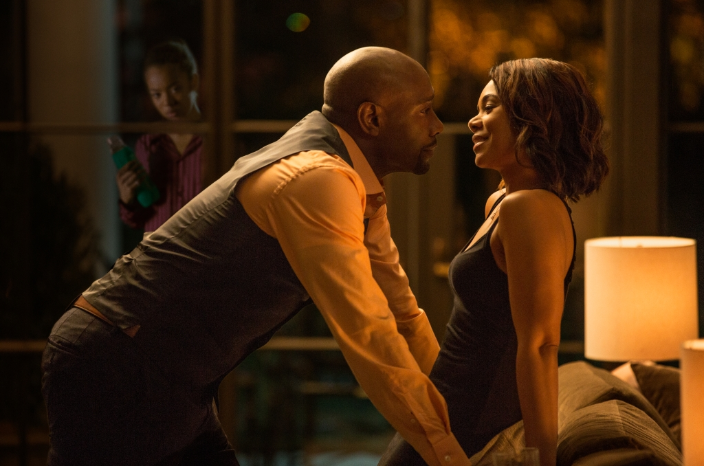 John Taylor (MORRIS CHESTNUT) with his wife Laura (REGINA HALL) have a romantic moment while Anna (Jaz Sinclair) watches them from outside in Screen Gems' WHEN THE BOUGH BREAKS.