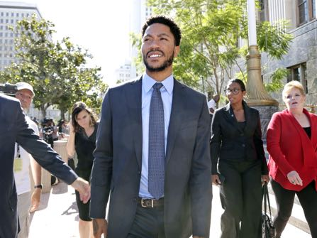 NBA star Derrick Rose smiles as he leaves federal court in Los Angeles Wednesday, Oct. 19, 2016. Jurors cleared Rose and two friends in a lawsuit that accused them of gang raping his ex-girlfriend when she was incapacitated from drugs or alcohol. The jury reached the verdict Wednesday in Los Angeles federal court after hearing dramatically different accounts of the August 2013 sexual encounter. (AP Photo/Nick Ut)