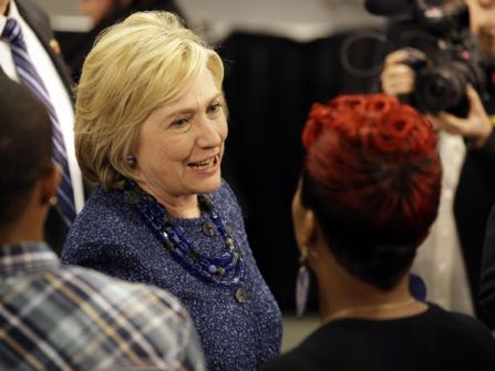 FILE - In this Dec. 11, 2015 file photo, Democratic presidential candidate Hillary Clinton speaks to Lesley McSpadden, right, the mother of Michael Brown, while working the rope line during a campaign stop at a union hall in St. Louis. Brown was shot and killed by a Ferguson police officer in Aug. 2014 setting off the Black Lives Matter movement. African-American voters are seen as key to Clinton's path to victory in November. (AP Photo/Jeff Roberson, File)