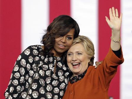 Democratic presidential candidate Hillary Clinton is hugged by first lady Michelle Obama during a campaign rally in Winston-Salem, N.C., Thursday, Oct. 27, 2016. (AP Photo/Chuck Burton)