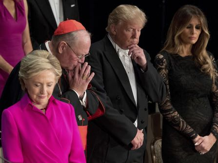 From left, Democratic presidential candidate Hillary Clinton, Cardinal Timothy Dolan, Archbishop of New York, Republican presidential candidate Donald Trump, and his wife Melania Trump, stand for the invocation at the 71st annual Alfred E. Smith Memorial Foundation Dinner, a charity gala organized by the Archdiocese of New York, Thursday, Oct. 20, 2016, at the Waldorf Astoria hotel in New York. (AP Photo/Andrew Harnik)