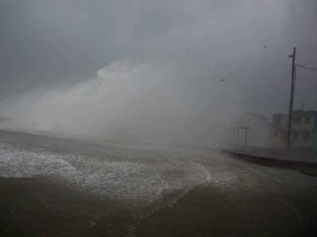 A wave crashes on the waterfront in Baracoa, Cuba, Tuesday, Oct. 4, 2016. (AP Photo/Ramon Espinosa)