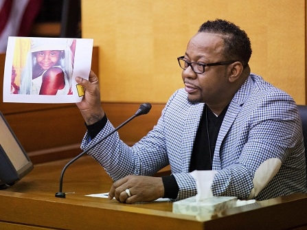 Bobby Brown holds up a picture of his daughter, Bobbi Kristina Brown, during a wrongful death case against her partner, Nick Gordon, in Atlanta, Thursday, Nov. 17, 2016. Bobbi Kristina, the daughter of singers Brown and Whitney Houston, was found face-down and unresponsive in a bathtub in her suburban Atlanta townhome in January 2015. (AP Photo/David Goldman, Pool)