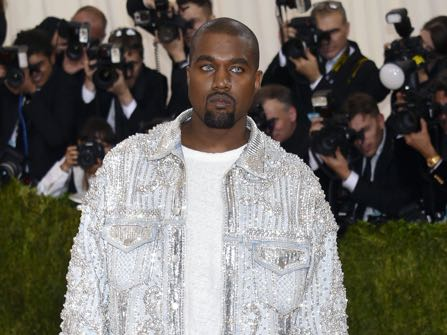 """Kanye West arrives at The Metropolitan Museum of Art Costume Institute Benefit Gala, celebrating the opening of """"Manus x Machina: Fashion in an Age of Technology"""" on Monday, May 2, 2016, in New York. (Photo by Evan Agostini/Invision/AP)"""