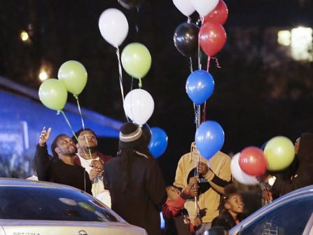 People release balloons outside New Monumental Baptist Church Tuesday, Nov. 22, 2016, in Chattanooga, Tenn. A service was held at the church for victims of a school bus that crashed Monday, killing five children from Woodmore Elementary School. The bus, driven by Johnthony Walker, 24, crashed while transporting children home from the school. Walker has been arrested on charges including vehicular homicide, reckless driving and reckless endangerment. (AP Photo/Mark Humphrey)