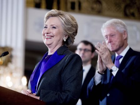 FILE- In this Nov. 9, 2016, file photo, Hillary Clinton, accompanied by former President Bill Clinton, right, pauses while speaking to staff and supporters at the New Yorker Hotel in New York. Hillary Clinton introduced singer and UNICEF Goodwill Ambassador Katy Perry on Tuesday, Nov. 29, at the annual event in New York. (AP Photo/Andrew Harnik, File)