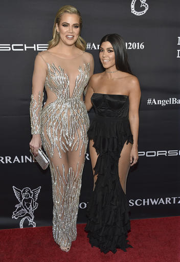 Khloe Kardashian, left, and Kourtney Kardashian attend the Angel Ball benefitting Gabrielle's Angel Foundation for Cancer Research at Cipriani Wall Street on Monday, Nov. 21, 2016, in New York. (Photo by Evan Agostini/Invision/AP)