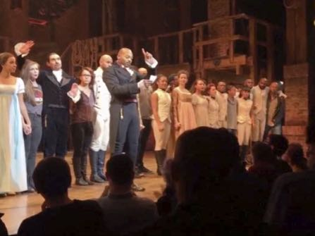 """In this image made from a video provided by Hamilton LLC, actor Brandon Victor Dixon who plays Aaron Burr, the nation's third vice president, in """"Hamilton"""" speaks from the stage after the curtain call in New York, Friday, Nov. 18, 2016. Vice President-elect Mike Pence is the latest celebrity to attend the Broadway hit """"Hamilton,"""" but the first to get a sharp message from a cast member from the stage. (Hamilton LLC via AP)"""