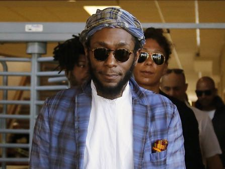 American actor and musician Mos Def leaves the Bellville Magistrates' Court in Bellville, South Africa, Thursday, March  24,  2016. Mos Def appeared on alleged charges for contravening immigrations laws in South Africa and the case was postponed till May 12, 2016. (AP Photo/Schalk van Zuydam)