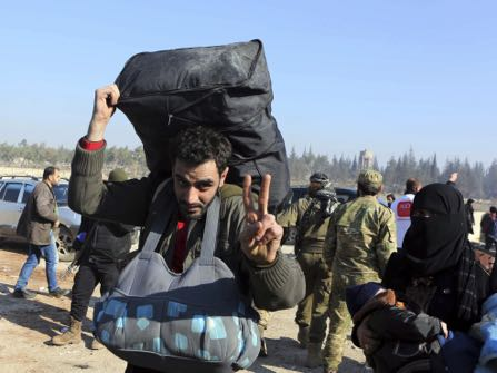 Syrians evacuated from the embattled Syrian city of Aleppo during the ceasefire arrive at a refugee camp in Rashidin, near Idlib, Syria, early Monday, Dec. 19, 2016. The Security Council on Monday approved the deployment of U.N. monitors to the Syrian city of Aleppo as the evacuation of fighters and civilians from the last remaining opposition stronghold resumed after days of delays. (AP Photo)