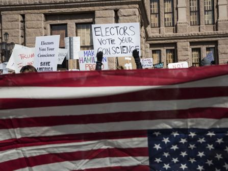 Demonstrators gather outside the Texas State Capitol in an attempt to influence the Republican electors from across the state to not vote for Donald Trump when they cast their formal ballots for president of the United States in Austin, Texas, Monday, Dec. 19, 2016. (AP Photo/Tamir Kalifa)