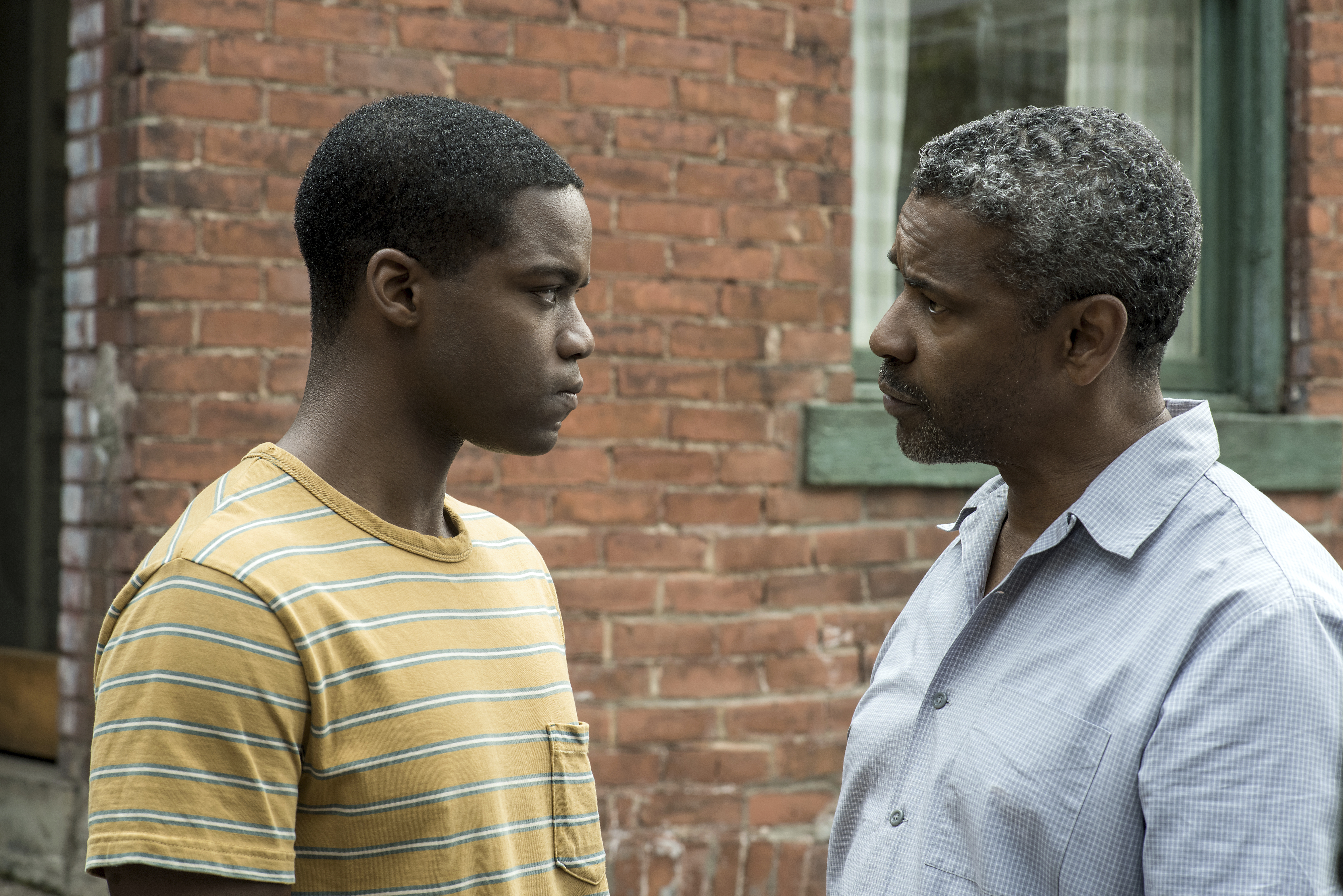 """This image released by Paramount Pictures shows Jovan Adepo, left, and Denzel Washington in a scene from """"Fences."""" (David Lee/Paramount Pictures via AP)"""