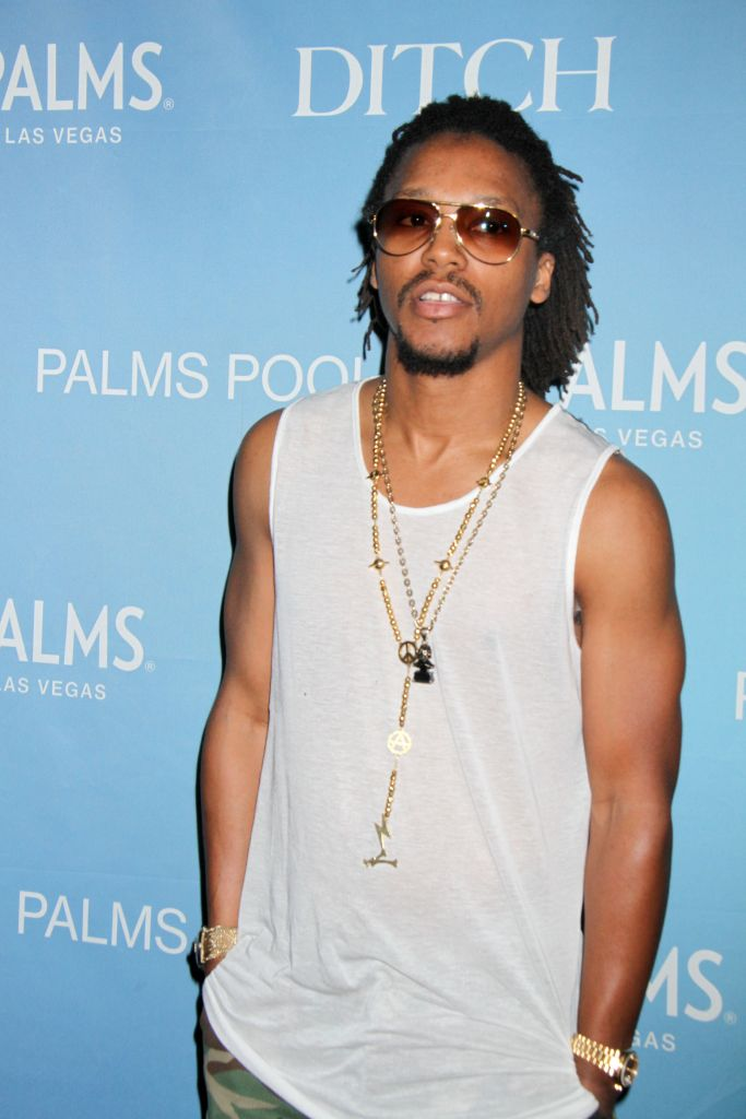 """08/23/2013 - Lupe Fiasco - Lupe Fiasco in Concert at """"Ditch Fridays"""" at Palms Pools and Dayclub in Las Vegas - August 23, 2013 - Palms Pools and Dayclub, Palms Resort Casino - Las Vegas, NV, USA - Keywords: 1/2 length shot, camouflage shorts, camouflage pants, camo pants, camo shorts, ring, rings, gold watch, gold bracelet, grey tank top shirt, necklace, necklaces, jewelry, pendant, charm, facial hair, beard, goatee, mustache, sunglasses, long braided black hair, updo, rap, american rapper, r&b, performer, performance, performing, singing, singer, dancer, Wasalu Jaco, Wasalu Muhammad Jaco, record producer, entrepreneur Orientation: Portrait Face Count: 1 - False - Photo Credit: PRN / PRPhotos.com - Contact (1-866-551-7827) - Portrait Face Count: 1"""