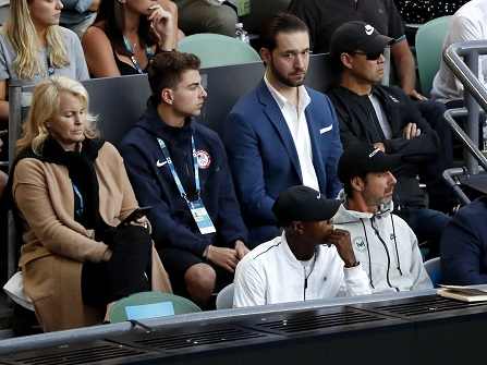 Supporters of United States' Serena Williams watch her match against sister Venus from the players box at the women's singles final at the Australian Open tennis championships in Melbourne, Australia, Saturday, Jan. 28, 2017. (AP Photo/Dita Alangkara)