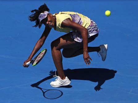United States' Venus Williams chases down a return shot to Switzerland's Stefanie Voegele during their second round match at the Australian Open tennis championships in Melbourne, Australia, Wednesday, Jan. 18, 2017. (AP Photo/Dita Alangkara)