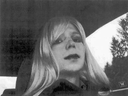 FILE - In this undated file photo provided by the U.S. Army, Pfc. Chelsea Manning poses for a photo wearing a wig and lipstick. Manning, a transgender soldier now serving 35 years at the Fort Leavenworth, Kansas military prison for leaking classified information to WikiLeaks, is asking President Barack Obama to commute her sentence to the 6 1/2 years she has already served. (U.S. Army via AP, File)