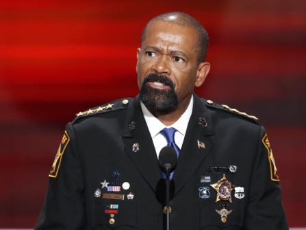 FILE - In this July 18, 2016 file photo, Milwaukee County Sheriff David Clarke speaks during the opening day of the Republican National Convention in Cleveland. Milwaukee resident Dan Black says Clarke had deputies question him after a flight because he shook his head at the lawman, who has gained national prominence for supporting Donald Trump. Black says in a complaint submitted to the sheriff's website he shook his head because Clarke was wearing Dallas Cowboys clothes on Sunday, Jan. 15, 2017, when they played the Green Bay Packers. (AP Photo/J. Scott Applewhite, File)