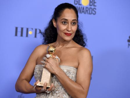 """Tracee Ellis Ross poses in the press room with the award for best performance by an actress in a television series - musical or comedy for """"Black-ish"""" at the 74th annual Golden Globe Awards at the Beverly Hilton Hotel on Sunday, Jan. 8, 2017, in Beverly Hills, Calif. (Photo by Jordan Strauss/Invision/AP)"""