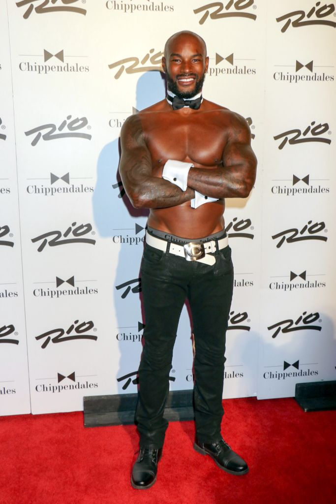 """08/28/2015 - Tyson Beckford - Tyson Beckford Returns to Celebrity Guest Host at Chippendales Theater in Las Vegas on August 28, 2015 - Chippendales Theater at Rio All-Suite Hotel & Casino - Las Vegas, NV, USA - Keywords: black shoes, full length shot, black pants, white belt, white cuffs, vertical, American fashion model, actor, tattoo, tattoos, shaved head, facial hair, beard, celebrity, celebrities, arts culture and entertainment, person, man, men, Nevada, shirtless, black bowtie, white collar, """"Make Me a Supermodel"""" Reality TV Show Orientation: Portrait Face Count: 1 - False - Photo Credit: PRN / PRPhotos.com - Contact (1-866-551-7827) - Portrait Face Count: 1"""