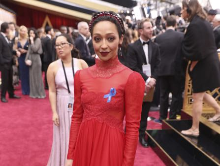 Ruth Negga, wearing the ACLU ribbon, arrives at the Oscars on Sunday, Feb. 26, 2017, at the Dolby Theatre in Los Angeles. (Photo by Matt Sayles/Invision/AP)