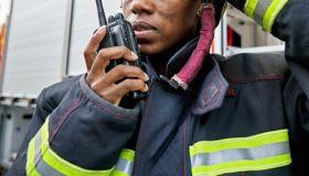 Black Female Firefighter Using Walkie-Talkie